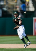 Eric Sogard of the Oakland Athletics throws out Marwin Gonzalez of the Houston Astros in the top of the ninth inning at Oco Coliseum on April 20 2014...