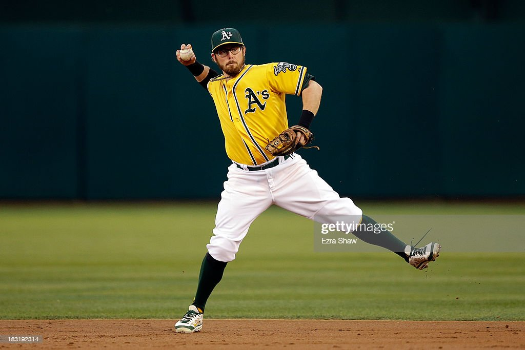 <a gi-track='captionPersonalityLinkClicked' href=/galleries/search?phrase=Eric+Sogard&family=editorial&specificpeople=6796459 ng-click='$event.stopPropagation()'>Eric Sogard</a> #28 of the Oakland Athletics throws out Victor Martinez #41 of the Detroit Tigers in the second inning during Game Two of the American League Division Series at O.co Coliseum on October 5, 2013 in Oakland, California.