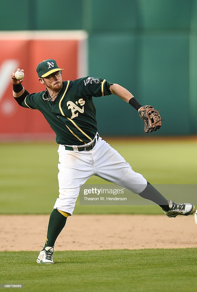 <a gi-track='captionPersonalityLinkClicked' href=/galleries/search?phrase=Eric+Sogard&family=editorial&specificpeople=6796459 ng-click='$event.stopPropagation()'>Eric Sogard</a> #28 of the Oaklandn Athletics makes an off balance throw to throw out John Buck #4 of the Seattle Mariners (not pictured) in the top of the eighth inning during game two of a doubleheader at O.co Coliseum on May 7, 2014 in Oakland, California.