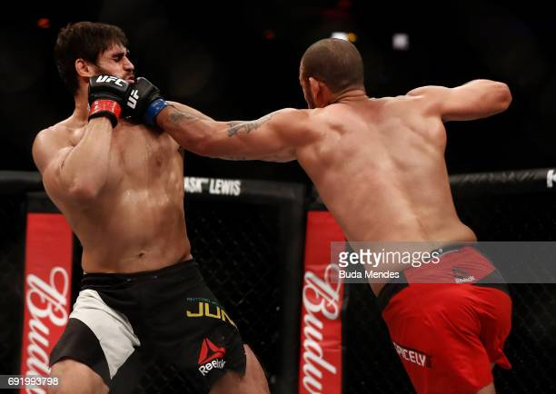 Eric Spicely punches Antonio Carlos Junior of Brazil in their middleweight bout during the UFC 212 event at Jeunesse Arena on June 3 2017 in Rio de...