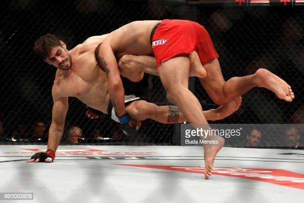 Eric Spicely takes down Antonio Carlos Junior of Brazil in their middleweight bout during the UFC 212 event at Jeunesse Arena on June 3 2017 in Rio...