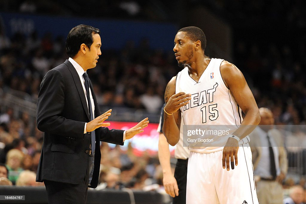 Eric Spolestra head coach of the Miami Heat talks to Mario Chalmers #15 during a timeout against the Orlando Magic at Amway Center on March 25, 2013 in Orlando, Florida.