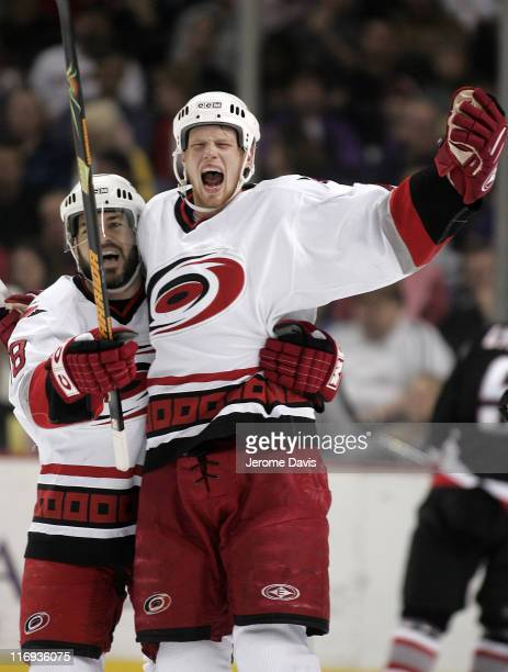 Eric Staal and Mark Recchi celebrate the Carolina Hurricanes celebrate their second goal of the first period first during game 4 of the Eastern...