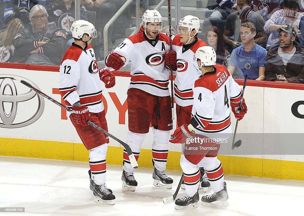 <a gi-track='captionPersonalityLinkClicked' href=/galleries/search?phrase=Eric+Staal&family=editorial&specificpeople=202199 ng-click='$event.stopPropagation()'>Eric Staal</a> #12, <a gi-track='captionPersonalityLinkClicked' href=/galleries/search?phrase=Jordan+Staal&family=editorial&specificpeople=533044 ng-click='$event.stopPropagation()'>Jordan Staal</a> #11, <a gi-track='captionPersonalityLinkClicked' href=/galleries/search?phrase=Alexander+Semin&family=editorial&specificpeople=206654 ng-click='$event.stopPropagation()'>Alexander Semin</a> #28 and <a gi-track='captionPersonalityLinkClicked' href=/galleries/search?phrase=Andrej+Sekera&family=editorial&specificpeople=722503 ng-click='$event.stopPropagation()'>Andrej Sekera</a> #4 of the Carolina Hurricanes celebrate a second period goal against the Winnipeg Jets at the MTS Centre on March 22, 2014 in Winnipeg, Manitoba, Canada.