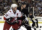 Eric Staal of the Carolina Hurricanes and Jordan Staal of the Pittsburgh Penguins battle for position in the third period at Mellon Arena on December...
