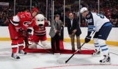 Eric Staal of the Carolina Hurricanes and Nik Antropov of the Winnipeg Jets meet for the ceremonial puck drop by Charlotte Checkers CEO Michael Kahn...