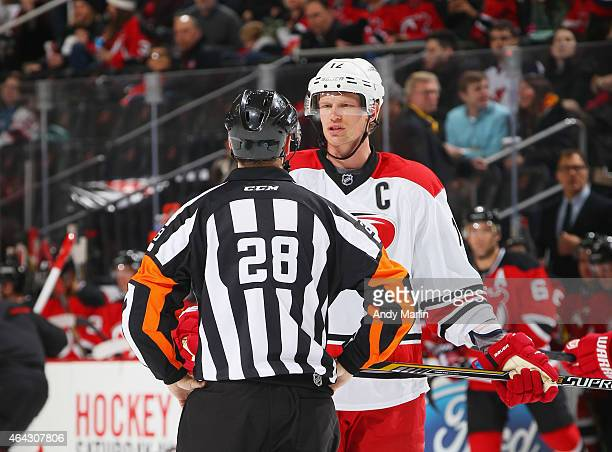 Eric Staal of the Carolina Hurricanes and referee Chris Lee talk during a timeout during the game against the New Jersey Devils at the Prudential...