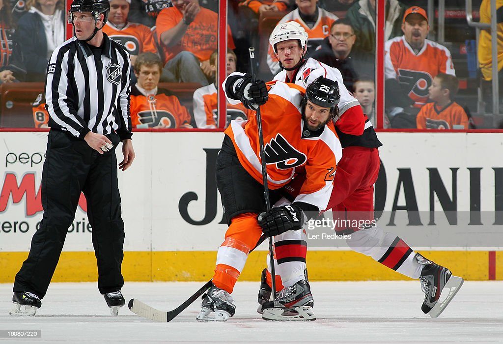 Eric Staal #12 of the Carolina Hurricanes battles against Max Talbot #25 of the Philadelphia Flyers on February 2, 2013 at the Wells Fargo Center in Philadelphia, Pennsylvania.