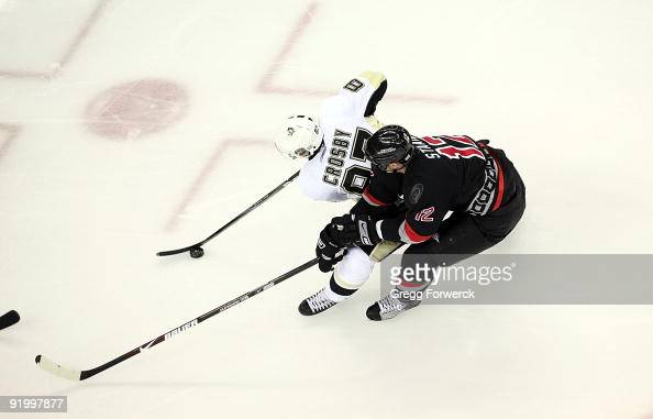 Eric Staal of the Carolina Hurricanes battles for the puck with Sidney Crosby of the Pittsburgh Penguins during a NHL game on October 14 2009 at RBC...