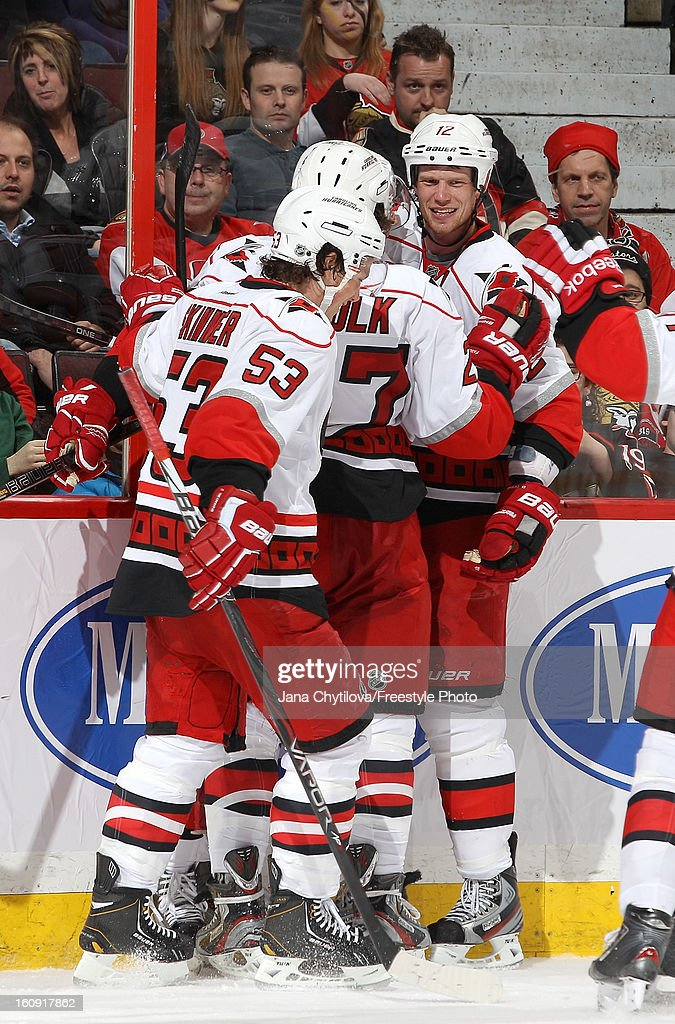 <a gi-track='captionPersonalityLinkClicked' href=/galleries/search?phrase=Eric+Staal&family=editorial&specificpeople=202199 ng-click='$event.stopPropagation()'>Eric Staal</a> #12 of the Carolina Hurricanes celebrates a game tying third period with team mate <a gi-track='captionPersonalityLinkClicked' href=/galleries/search?phrase=Jeff+Skinner&family=editorial&specificpeople=3147596 ng-click='$event.stopPropagation()'>Jeff Skinner</a> #53, during an NHL game against the Ottawa Senators at Scotiabank Place on February 7, 2013 in Ottawa, Ontario, Canada.