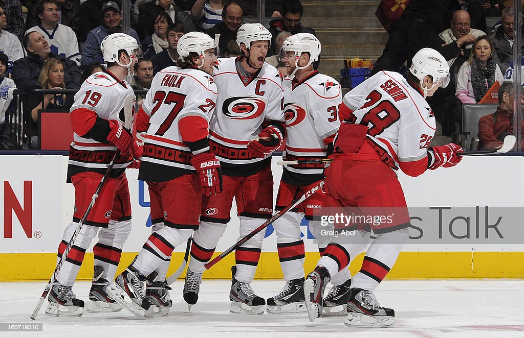 Eric Staal #12 of the Carolina Hurricanes celebrates a second period goal with teammates during NHL game action against the Toronto Maple Leafs February 4, 2013 at the Air Canada Centre in Toronto, Ontario, Canada.