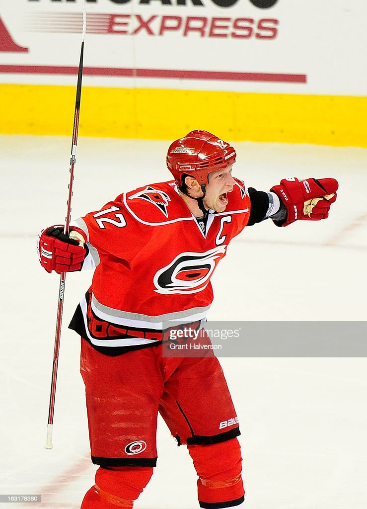 Eric Staal #12 of the Carolina Hurricanes celebrates after assisting on the game-winning goal by teammate Alexander Semin #28 against the Buffalo Sabres during the third period at PNC Arena on March 5, 2013 in Raleigh, North Carolina. The Hurricanes won 4-3.