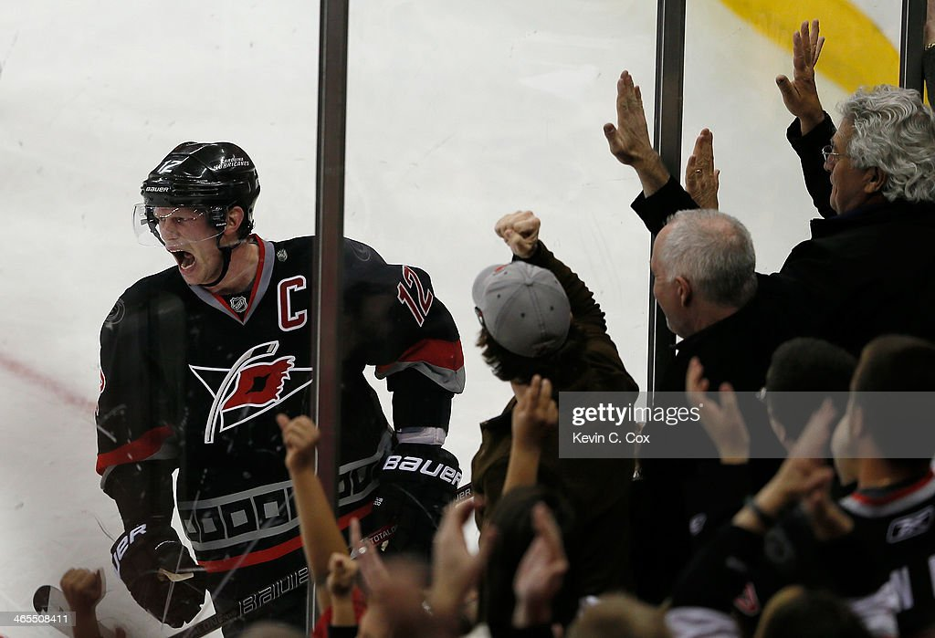 Eric Staal #12 of the Carolina Hurricanes celebrates his game-tying goal against the Columbus Blue Jackets at PNC Arena on January 27, 2014 in Raleigh, North Carolina.