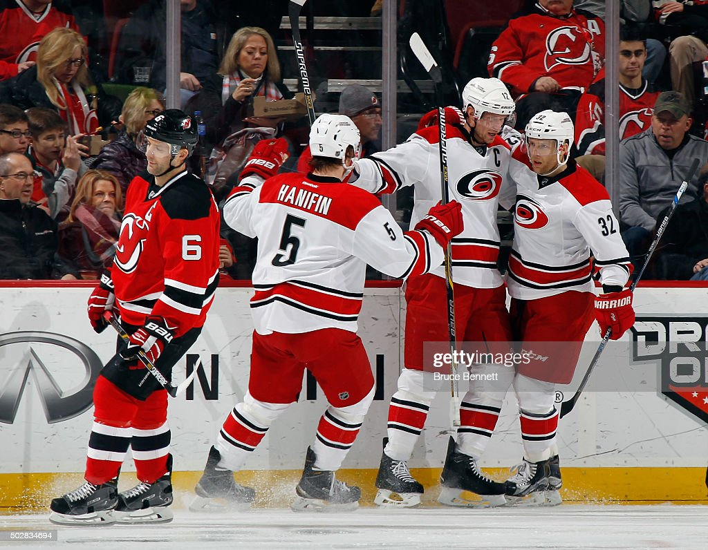 <a gi-track='captionPersonalityLinkClicked' href=/galleries/search?phrase=Eric+Staal&family=editorial&specificpeople=202199 ng-click='$event.stopPropagation()'>Eric Staal</a> #12 of the Carolina Hurricanes (c) celebrates his goal at 2:51 of the second period against the New Jersey Devils along with <a gi-track='captionPersonalityLinkClicked' href=/galleries/search?phrase=Noah+Hanifin&family=editorial&specificpeople=13708549 ng-click='$event.stopPropagation()'>Noah Hanifin</a> #5 (l) and <a gi-track='captionPersonalityLinkClicked' href=/galleries/search?phrase=Kris+Versteeg&family=editorial&specificpeople=2242969 ng-click='$event.stopPropagation()'>Kris Versteeg</a> #32 (r) at the Prudential Center on December 29, 2015 in Newark, New Jersey.