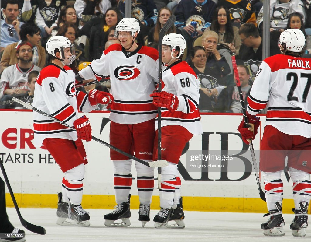 <a gi-track='captionPersonalityLinkClicked' href=/galleries/search?phrase=Eric+Staal&family=editorial&specificpeople=202199 ng-click='$event.stopPropagation()'>Eric Staal</a> #12 of the Carolina Hurricanes celebrates his goal with <a gi-track='captionPersonalityLinkClicked' href=/galleries/search?phrase=Andrei+Loktionov&family=editorial&specificpeople=5370946 ng-click='$event.stopPropagation()'>Andrei Loktionov</a> #8 and <a gi-track='captionPersonalityLinkClicked' href=/galleries/search?phrase=Chris+Terry+-+Ice+Hockey+Player&family=editorial&specificpeople=4605771 ng-click='$event.stopPropagation()'>Chris Terry</a> #58 during the third period against the Pittsburgh Penguins on April 1, 2014 at Consol Energy Center in Pittsburgh, Pennsylvania.