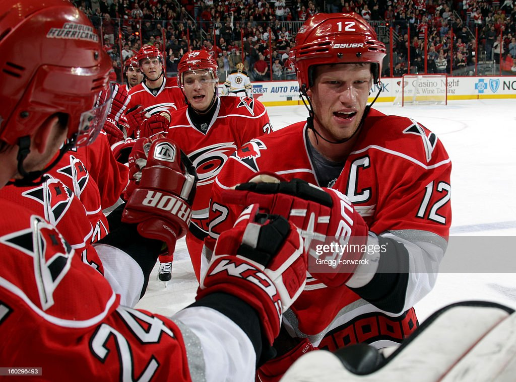 Eric Staal #12 of the Carolina Hurricanes celebrates his second-period goal against the Boston Bruins during their NHL game on January 28, 2013 at PNC Arena in Raleigh North Carolina.