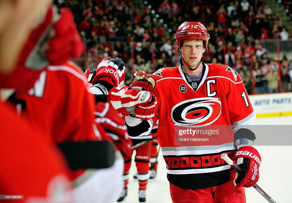 <a gi-track='captionPersonalityLinkClicked' href=/galleries/search?phrase=Eric+Staal&family=editorial&specificpeople=202199 ng-click='$event.stopPropagation()'>Eric Staal</a> #12 of the Carolina Hurricanes celebrates with teammates after scoring a second-period goal against the Nashville Predators during play at the RBC Center on February 28, 2012 in Raleigh, North Carolina.