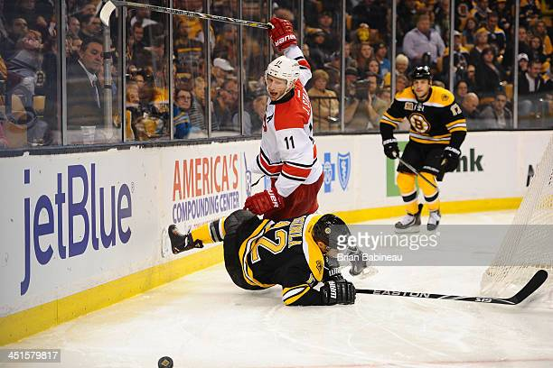 Eric Staal of the Carolina Hurricanes checks against Jarome Iginla of the Boston Bruins at the TD Garden on November 23 2013 in Boston Massachusetts