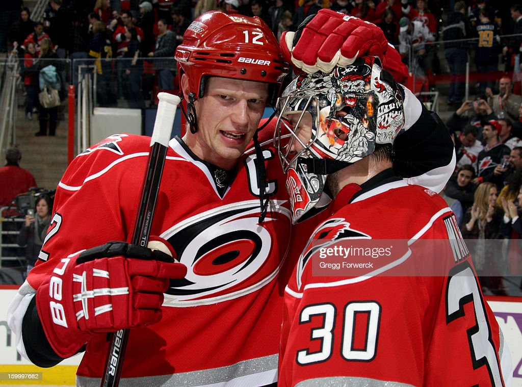 Eric Staal #12 of the Carolina Hurricanes congratulates Cam Ward #30 following a victory over the Buffalo Sabres during an NHL game at PNC Arena on January 24, 2013.