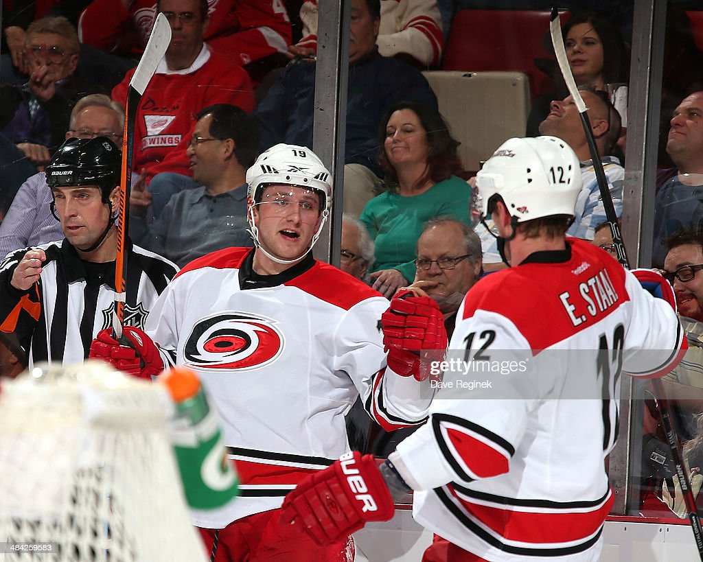 <a gi-track='captionPersonalityLinkClicked' href=/galleries/search?phrase=Eric+Staal&family=editorial&specificpeople=202199 ng-click='$event.stopPropagation()'>Eric Staal</a> #12 of the Carolina Hurricanes congratulates teammate <a gi-track='captionPersonalityLinkClicked' href=/galleries/search?phrase=Jiri+Tlusty&family=editorial&specificpeople=543236 ng-click='$event.stopPropagation()'>Jiri Tlusty</a> #19 for scoring a first period goal during an NHL game against the Detroit Red Wings on April 11, 2014 at Joe Louis Arena in Detroit, Michigan.