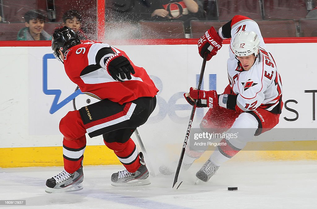 Eric Staal #12 of the Carolina Hurricanes controls the puck against Milan Michalek #9 of the Ottawa Senators on February 7, 2013 at Scotiabank Place in Ottawa, Ontario, Canada.