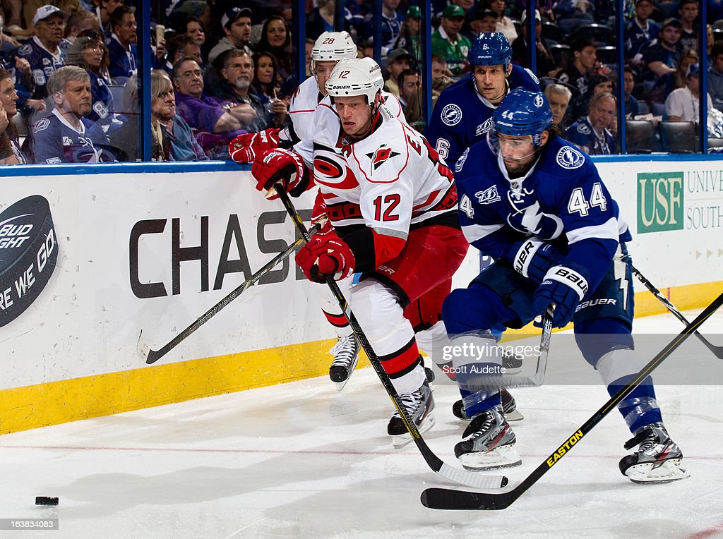 <a gi-track='captionPersonalityLinkClicked' href=/galleries/search?phrase=Eric+Staal&family=editorial&specificpeople=202199 ng-click='$event.stopPropagation()'>Eric Staal</a> #12 of the Carolina Hurricanes fights for position and control of the puck with Nate Thompson #44 of the Tampa Bay Lightning during the second period of the game at the Tampa Bay Times Forum on March 16, 2013 in Tampa, Florida.