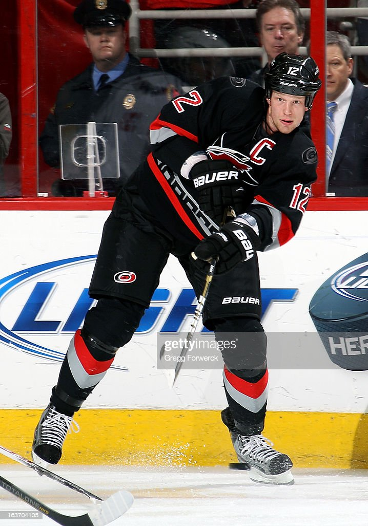 <a gi-track='captionPersonalityLinkClicked' href=/galleries/search?phrase=Eric+Staal&family=editorial&specificpeople=202199 ng-click='$event.stopPropagation()'>Eric Staal</a> #12 of the Carolina Hurricanes fires a centering pass during an NHL game against the Washington Capitals at PNC Arena on March 14, 2013 in Raleigh, North Carolina.