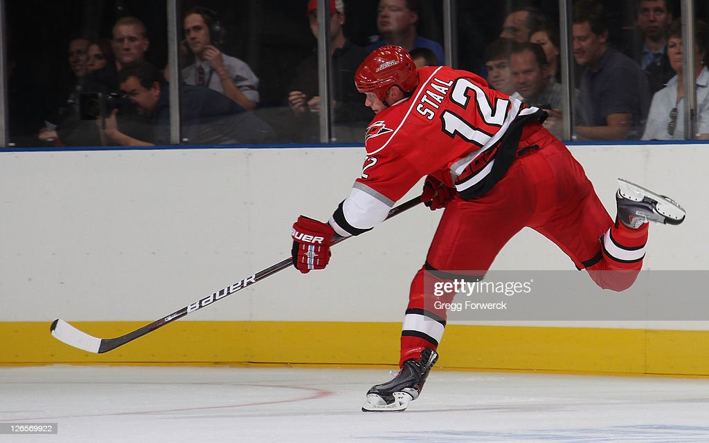 <a gi-track='captionPersonalityLinkClicked' href=/galleries/search?phrase=Eric+Staal&family=editorial&specificpeople=202199 ng-click='$event.stopPropagation()'>Eric Staal</a> #12 of the Carolina Hurricanes fires a shot during an NHL preseason game against the Winnipeg Jets on September 25, 2011 at Time Warner Arena in Charlotte, North Carolina.