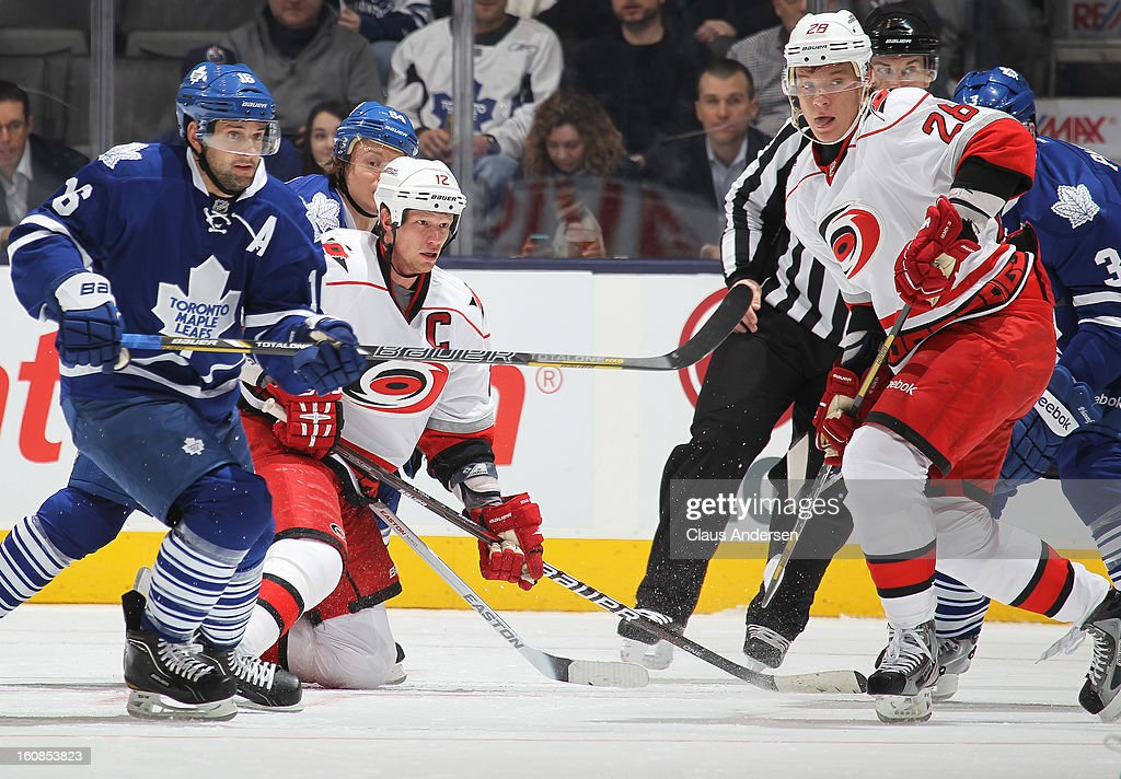 Eric Staal #12 of the Carolina Hurricanes keeps an eye on the puck while getting up in a game against the Toronto Maple Leafs on February 4, 2013 at the Air Canada Centre in Toronto, Canada. The Hurricanes defeated the Leafs 4-1.