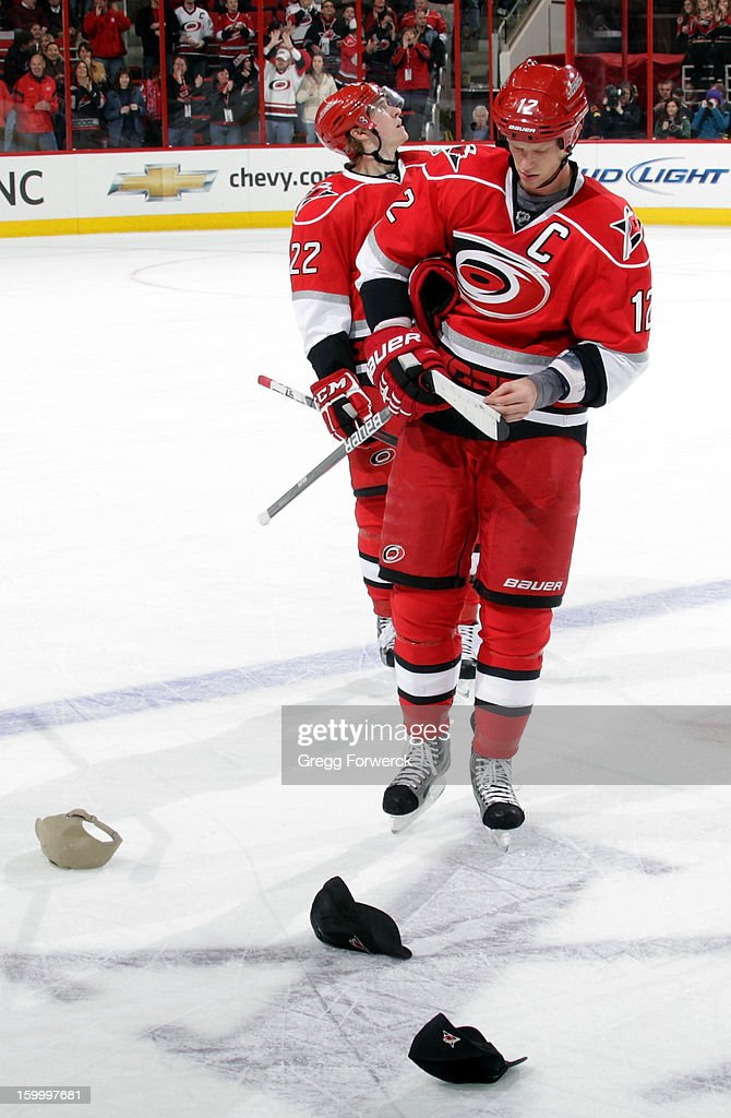 <a gi-track='captionPersonalityLinkClicked' href=/galleries/search?phrase=Eric+Staal&family=editorial&specificpeople=202199 ng-click='$event.stopPropagation()'>Eric Staal</a> #12 of the Carolina Hurricanes looks down at a few remaining hats on the ice following his third goal during an NHL game against the Buffalo Sabres at PNC Arena on January 24, 2013.