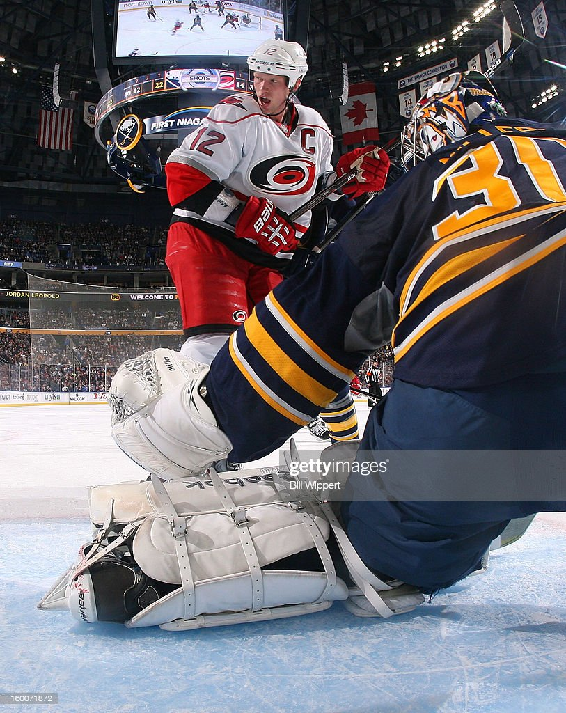 Eric Staal #12 of the Carolina Hurricanes looks for the rebound in front of goaltender Ryan Miller #30 of the Buffalo Sabres on January 25, 2013 at the First Niagara Center in Buffalo, New York.