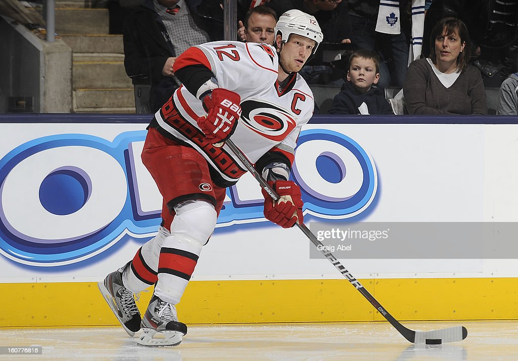 Eric Staal #12 of the Carolina Hurricanes looks to pass the puck during NHL game action against the Toronto Maple Leafs February 4, 2013 at the Air Canada Centre in Toronto, Ontario, Canada.