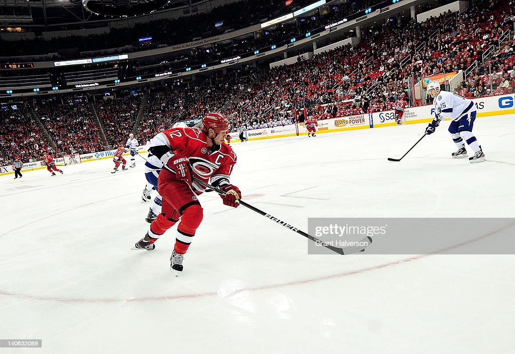 <a gi-track='captionPersonalityLinkClicked' href=/galleries/search?phrase=Eric+Staal&family=editorial&specificpeople=202199 ng-click='$event.stopPropagation()'>Eric Staal</a> #12 of the Carolina Hurricanes moves the puck against the Tampa Bay Lightning during play at the RBC Center on March 3, 2012 in Raleigh, North Carolina.