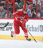 Eric Staal of the Carolina Hurricanes moves the puck along the boards during their NHL game against the Ottawa Senators at PNC Arena on March 17 2015...
