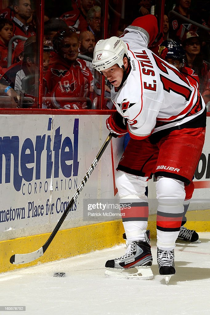 <a gi-track='captionPersonalityLinkClicked' href=/galleries/search?phrase=Eric+Staal&family=editorial&specificpeople=202199 ng-click='$event.stopPropagation()'>Eric Staal</a> #12 of the Carolina Hurricanes plays the buck along the boards during the second period of an NHL game against the Washington Capitals at Verizon Center on March 12, 2013 in Washington, DC.
