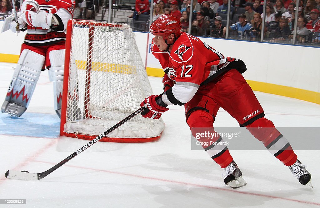 <a gi-track='captionPersonalityLinkClicked' href=/galleries/search?phrase=Eric+Staal&family=editorial&specificpeople=202199 ng-click='$event.stopPropagation()'>Eric Staal</a> #12 of the Carolina Hurricanes plays the puck behind the net during an NHL preseason game against the Winnipeg Jets on September 25, 2011 at Time Warner Arena in Charlotte, North Carolina.