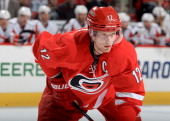 Eric Staal of the Carolina Hurricanes prepares for a faceoff during their NHL game against the Washington Capitals at PNC Arena on April 10 2014 in...