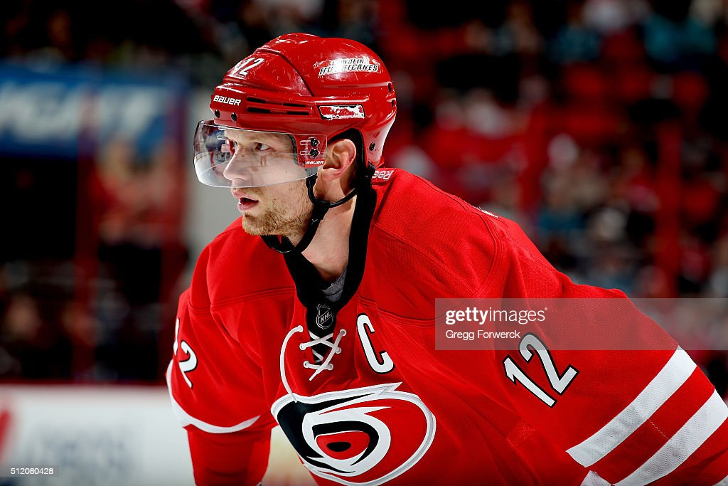 Eric Staal of the Carolina Hurricanes prepares for a faceoff during an NHL game against the San Jose Sharks at PNC Arena on February 19 2016 in...