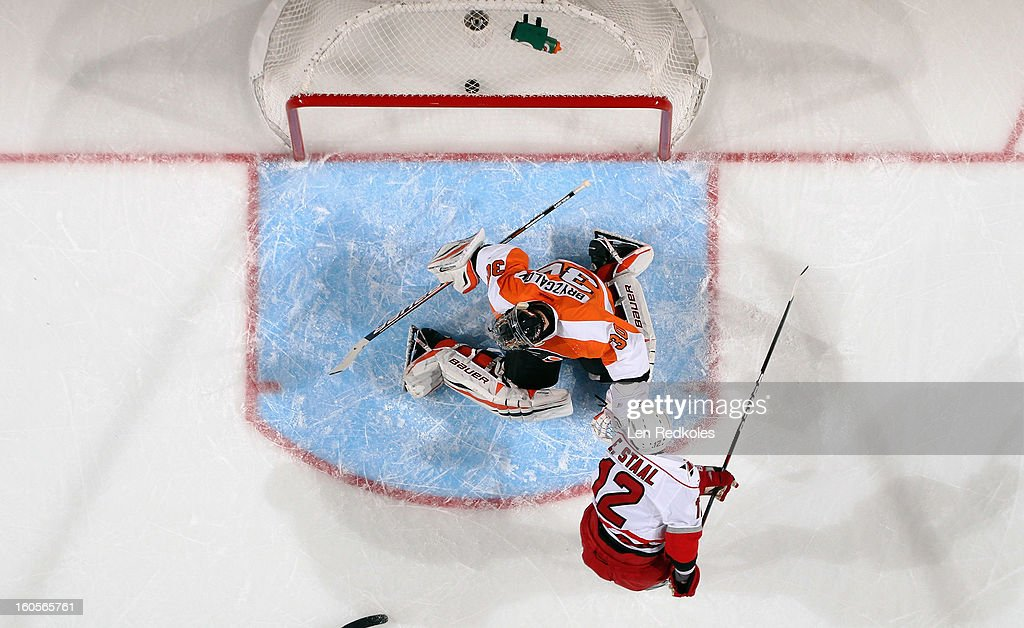 Eric Staal #12 of the Carolina Hurricanes scores a goal against Ilya Bryzgalov #30 of the Philadelphia Flyers in the first period on February 2, 2013 at the Wells Fargo Center in Philadelphia, Pennsylvania. The Flyers won 5-3.