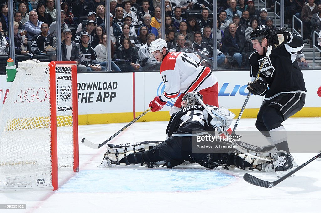 Eric Staal #12 of the Carolina Hurricanes scores against Jonathan Quick #32 of the Los Angeles Kings at STAPLES Center on November 20, 2014 in Los Angeles, California.