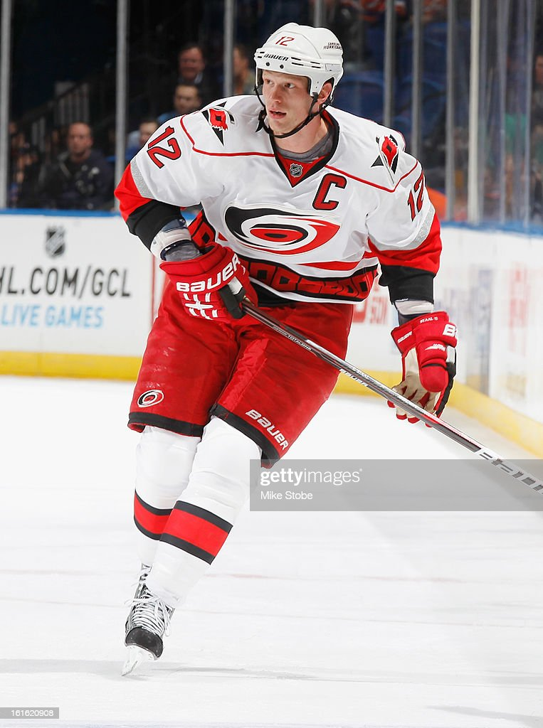 Eric Staal #12 of the Carolina Hurricanes skates against the New York Islanders at Nassau Veterans Memorial Coliseum on February 11, 2013 in Uniondale, New York. The Hurricanes defeated the Islanders 6-4.
