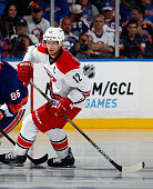 Eric Staal of the Carolina Hurricanes skates against the New York Islanders at the Nassau Veterans Memorial Coliseum on October 11 2014 in Uniondale...