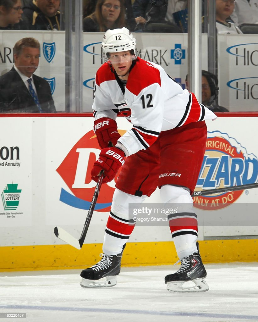 <a gi-track='captionPersonalityLinkClicked' href=/galleries/search?phrase=Eric+Staal&family=editorial&specificpeople=202199 ng-click='$event.stopPropagation()'>Eric Staal</a> #12 of the Carolina Hurricanes skates against the Pittsburgh Penguins on April 1, 2014 at Consol Energy Center in Pittsburgh, Pennsylvania.
