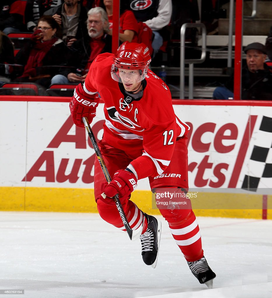 Eric Staal of the Carolina Hurricanes skates for position on the ice during their NHL game against the Washington Capitals at PNC Arena on December 4...