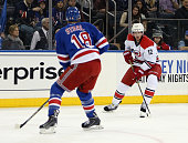 Eric Staal of the Carolina Hurricanes skates in on his brother Marc Staal of the New York Rangers during the first period at Madison Square Garden on...