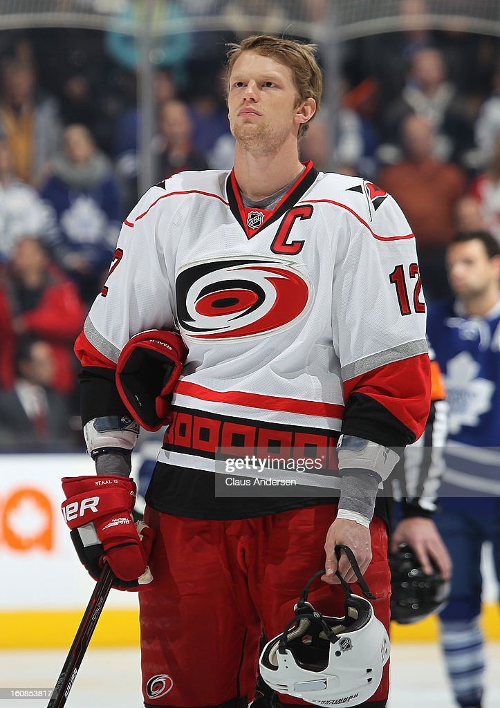 Eric Staal #12 of the Carolina Hurricanes stands for the playing of the national anthems prior to a game against the Toronto Maple Leafs on February 4, 2013 at the Air Canada Centre in Toronto, Canada. The Hurricanes defeated the Leafs 4-1.