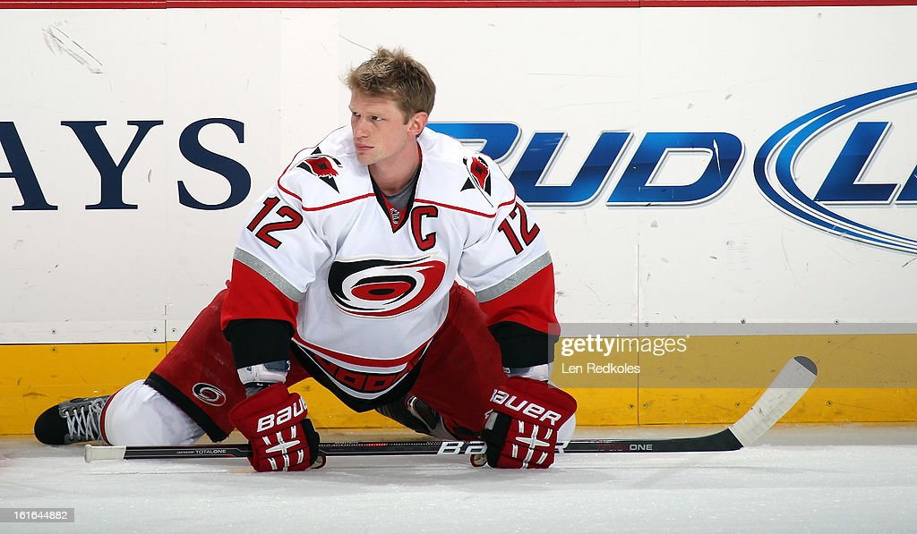 Eric Staal #12 of the Carolina Hurricanes stretches during warm ups prior to the game against the Philadelphia Flyers on February 9, 2013 at the Wells Fargo Center in Philadelphia, Pennsylvania.