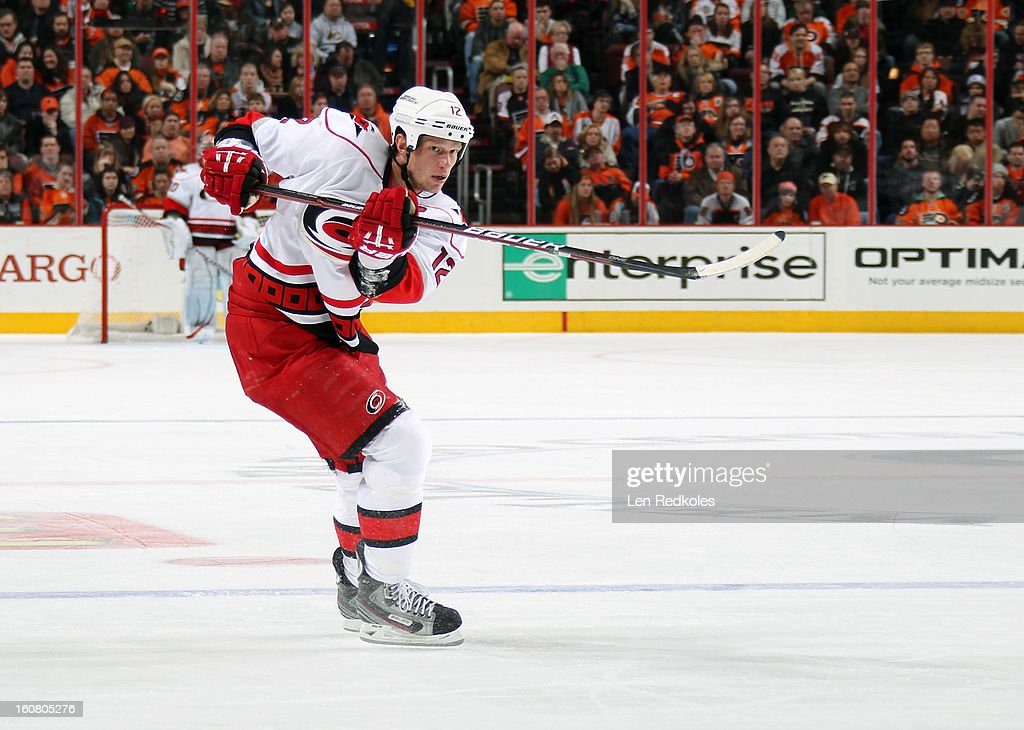 Eric Staal #12 of the Carolina Hurricanes takes a slapshot against the Philadelphia Flyers on February 2, 2013 at the Wells Fargo Center in Philadelphia, Pennsylvania.