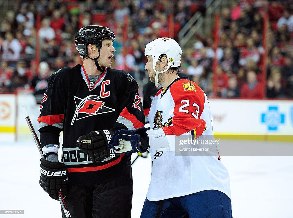 <a gi-track='captionPersonalityLinkClicked' href=/galleries/search?phrase=Eric+Staal&family=editorial&specificpeople=202199 ng-click='$event.stopPropagation()'>Eric Staal</a> #12 of the Carolina Hurricanes yells insults as Tyson Strachan #23 of the Florida Panthers shoves him away from the Panthers bench during play at PNC Arena on March 2, 2013 in Raleigh, North Carolina.