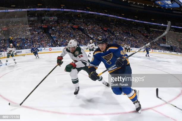 Eric Staal of the Minnesota Wild and Ivan Barbashev of the St Louis Blues battle for the puck in Game Three of the Western Conference First Round...